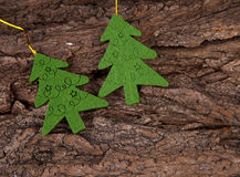 Two christmas trees on bark Stock Photography