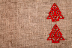 Two Christmas trees on burlap Royalty Free Stock Photography