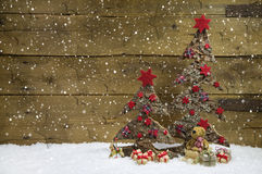 Two christmas trees with red christmas decoration on wooden back Stock Images