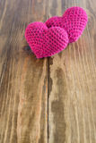 Two chrocheted hearts Stock Photo