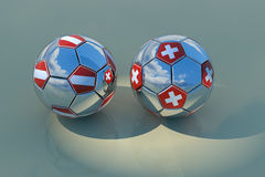 Two chrome balls with flags. Two reflecting balls with flags of Austria and Switzerland, 3D rendering with reflections and blue sky with clouds Stock Photo