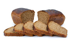 Two chunks of rye bread with anise and some slices Stock Photos