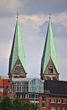 Two church spires over city skyline. Two spires of the cathedral in Bremen, Germany Royalty Free Stock Photo