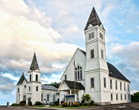 Two churches. Two white churches in a small town stock photo