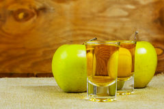 Two cider glasses  and green apples. On the rustic wooden background Stock Photography