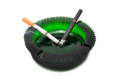 Two cigarette and ashtray Stock Photos