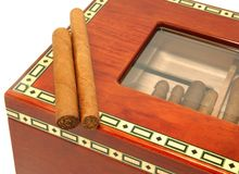 Two cigars on a humidor box Royalty Free Stock Image