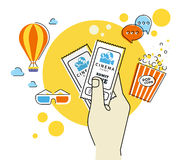 Two cinema tickets. Flat contour illustration of human hand holds two cinema tickets. Text outlined Stock Photos