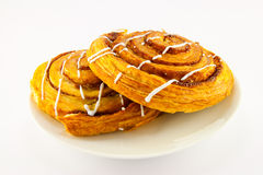 Two Cinnamon Buns. Two iced cinnamon buns with clipping path on a white background Stock Photos