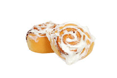 Two cinnamon buns with icing Royalty Free Stock Images