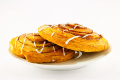 Two Cinnamon Buns On A White Plate Royalty Free Stock Image