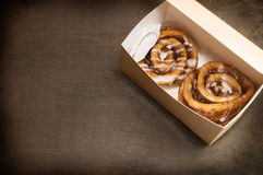 Two cinnamon rolls in box Stock Photos