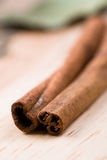 Two cinnamon sticks Royalty Free Stock Images