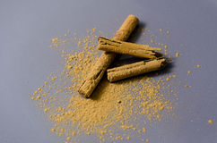 Two cinnamon sticks and powder Stock Image