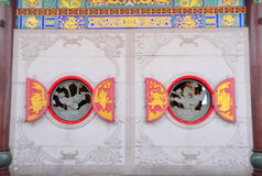Two circle chinese windows. Circle windows in Chinese temple Royalty Free Stock Photography