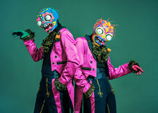 Two circus actors in zombie suit posing on studio Royalty Free Stock Images