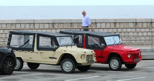 Two Citroen Mehari - Side View. Nice, France - May 21, 2019: Two Citroen Mehari, French Retro Cars Side View Parked In A Parking Lot In Nice On The French stock footage