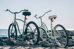 Two city bikes on the beach Royalty Free Stock Photos