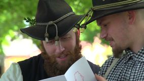 Two Civil War soldiers looking at a tintype. View of Two Civil War soldiers looking at a tintype stock video footage