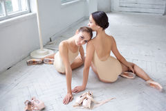 The two classic ballet dancers posing on white Royalty Free Stock Image