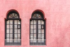 Two Classic Black Windows On Pink Wall With Copy Space Royalty Free Stock Photography