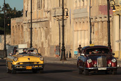 Two classic old American cars on Malecon. HAVANA, CUBA, FEBRUARY 16, 2014 : Classic old American car in the streets of Havana. Classic cars are still in use in Royalty Free Stock Images