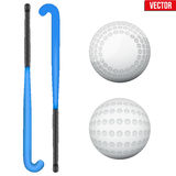 Two classic sticks and balls for field hockey. Two classic blue sticks and balls for field hockey. View from different sides. Sport Equipment. Editable Vector Royalty Free Stock Image