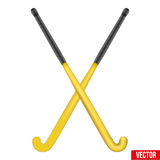 Two classic sticks for field hockey. Two classic yellow sticks for field hockey. View from different sides. Sport Equipment. Editable Vector illustration Stock Photos
