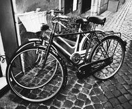 Two classic vintage retro city bicycles. Bw photo, Rome, Italy Royalty Free Stock Photography
