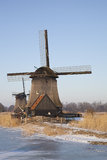 Two classic windmills Stock Images