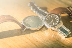 Two classic wrist watches on wood royalty free stock photography