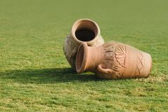 Two Clay amphora jug, old ceramic vases on green grass lawn. Sunny day.  stock photos