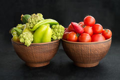 Two clay bowls with vegetables Royalty Free Stock Photography
