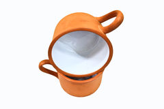 Two clay cup overlap on white background Royalty Free Stock Image