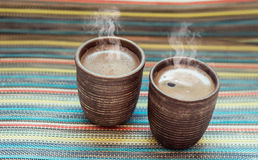Two clay cups with coffee Royalty Free Stock Photos