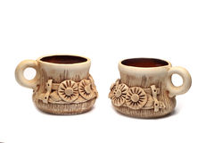 Two clay cups with floral ornament Royalty Free Stock Images