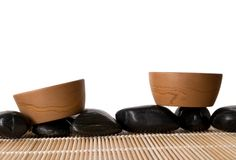 Two clay cups, mat and stones Stock Photo