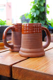 Two clay mugs of beer Royalty Free Stock Image