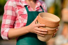 Two clay pots held by gardener close-up Stock Photography