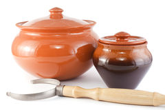 Two clay pots for roasting and the oven fork Stock Images