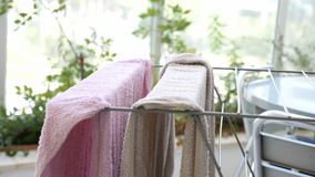 Two clean towels drying on a rail on a patio Royalty Free Stock Photo