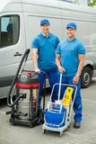 Two Cleaners Standing With Cleaning Equipments Stock Photography
