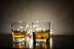 Two Clear Shot Glasses With Brandy Stock Photography