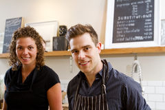 Two clerks in coffee shop Stock Photography