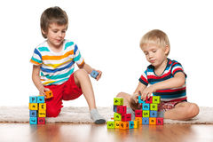 Two clever boys with blocks Stock Photos