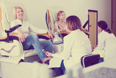 Two clients having pedicure royalty free stock images