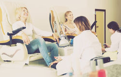 Two clients having pedicure royalty free stock photography