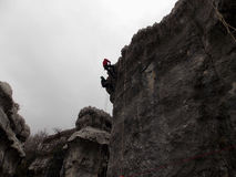 Two climber rappelling on the top of a cliff in Lebanon royalty free stock photo