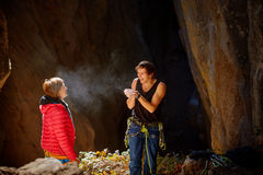 Two climbers in a cave Royalty Free Stock Photography