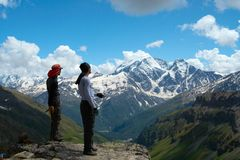 Two climbers looking at the mountains Royalty Free Stock Photo